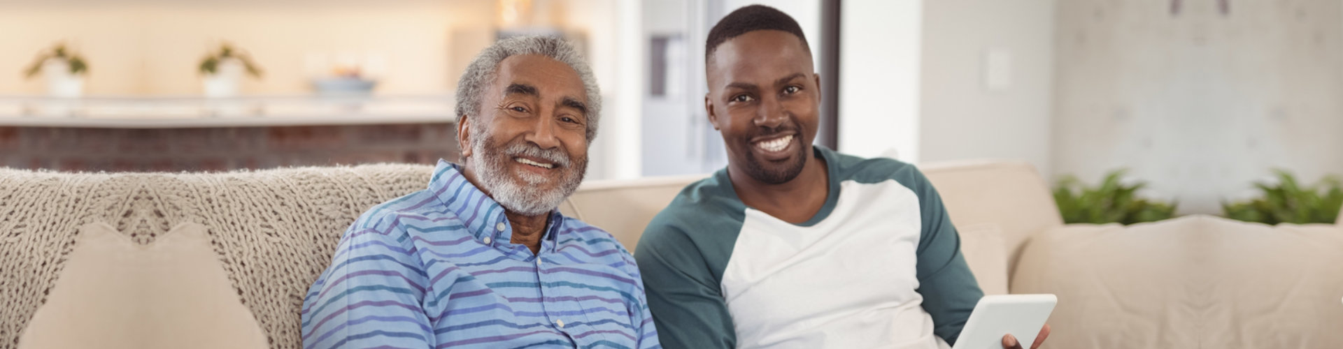 old man and caregiver smiling